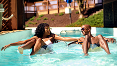 Guests floating down lazy river at Water Country USA