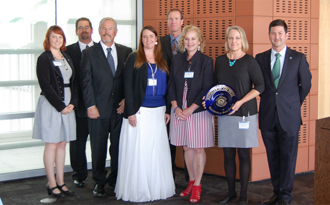 SeaWorld San Diego employees receiving award for waste reduction and recycling efforts