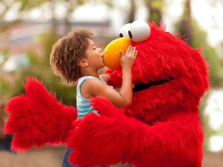 Child Kissing Elmo's Nose