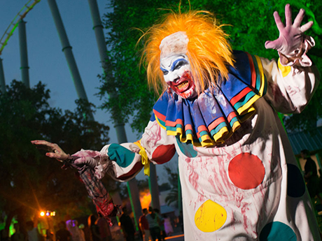 Scare Squad Scary Clown with Steel Eel Rollercoaster in Background