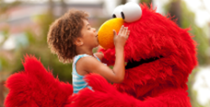Girl Kissing Elmo's Nose
