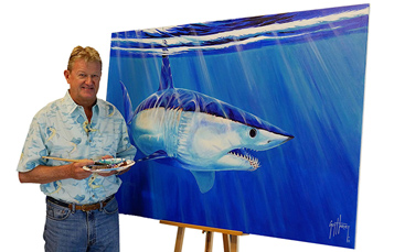 Guy Harvey standing in front of shark painting