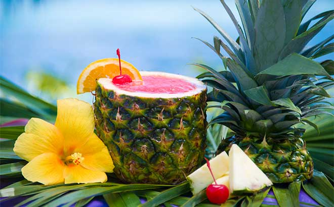 Taste delicious tropical drinks while you relax on the sandy beaches of Aquatica.