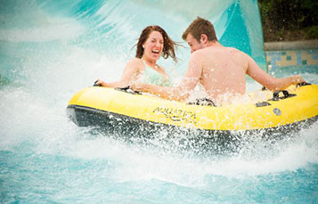 Take a slide down Wahalla Wave with your family at Aquatica.