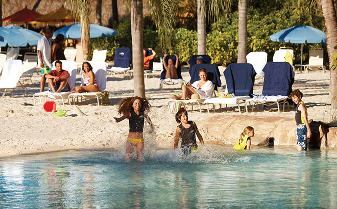 Splash and play on the white sandy beaches at Discovery Cove.