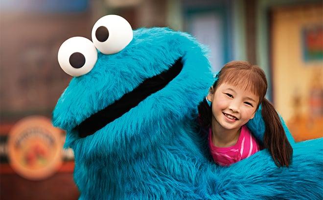 Cookie Monster and Girl Hug
