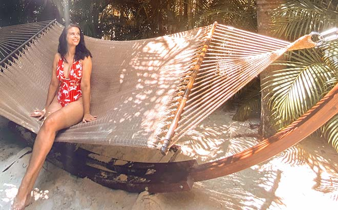 Sitting on a hammock at Discovery Cove Orlando with guest blogger, Carolina Grabova