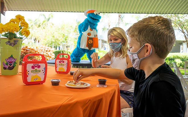 Decorating cookies with Cookie Monster at SeaWorld Halloween Spooktacular