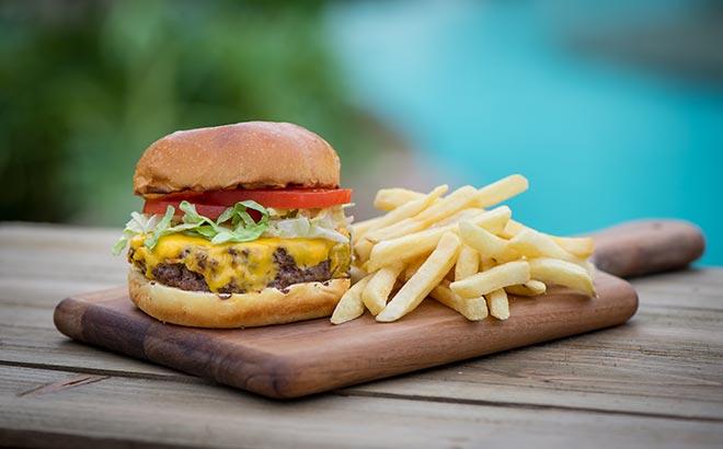 Enjoy a burger and fries at Aquatica Orlando