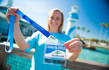Lady holding Annual Pass