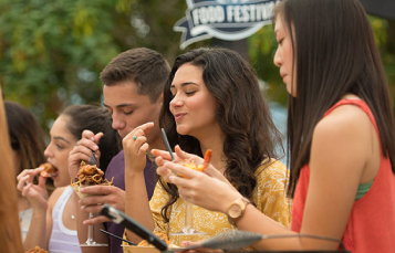 Teens enjoying SeaWorld's Seven Seas Food Festival