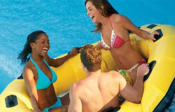 Teens on slide at Aquatica Orlando