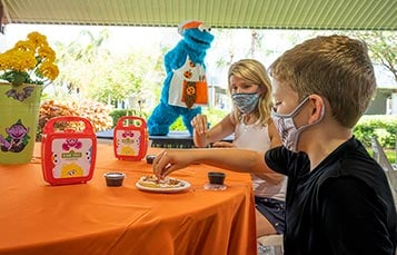 Decorating cookies with Cookies Monster at SeaWorld Halloween Spooktacular