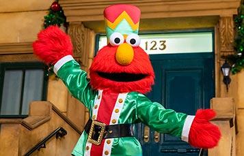 Elmo at the Sesame Street stoop during Christmas Celebration at SeaWorld Orlando