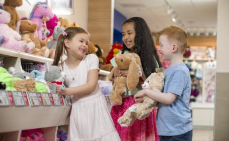 Kids inside Build-A-Bear store.