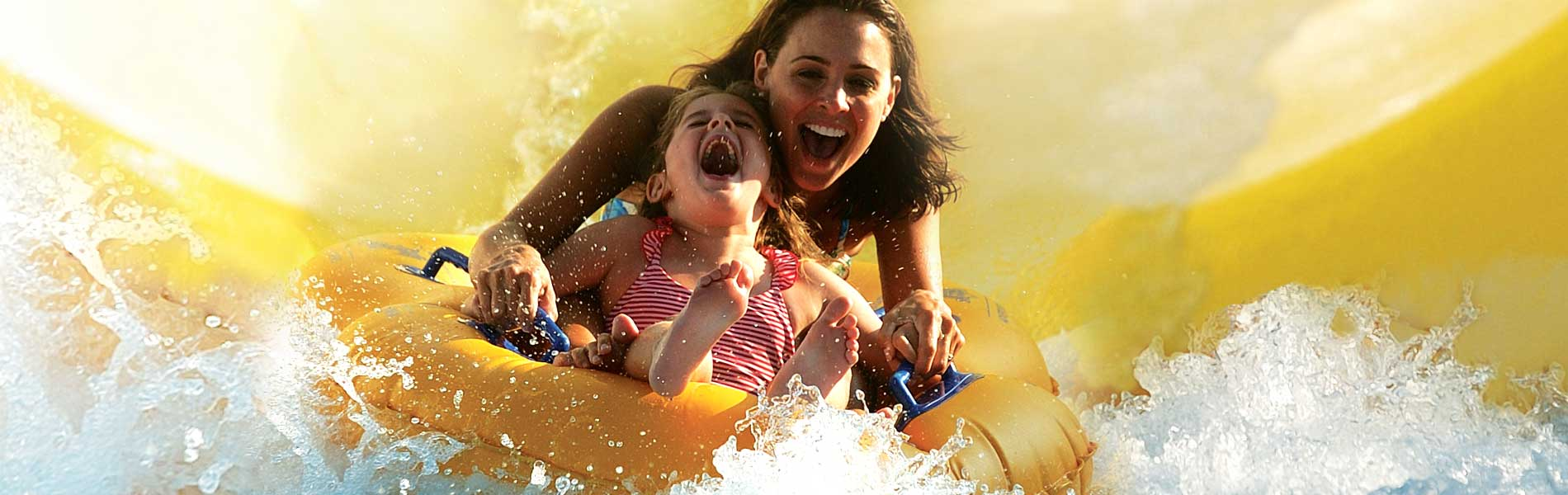 Mom and daughter on waterslide