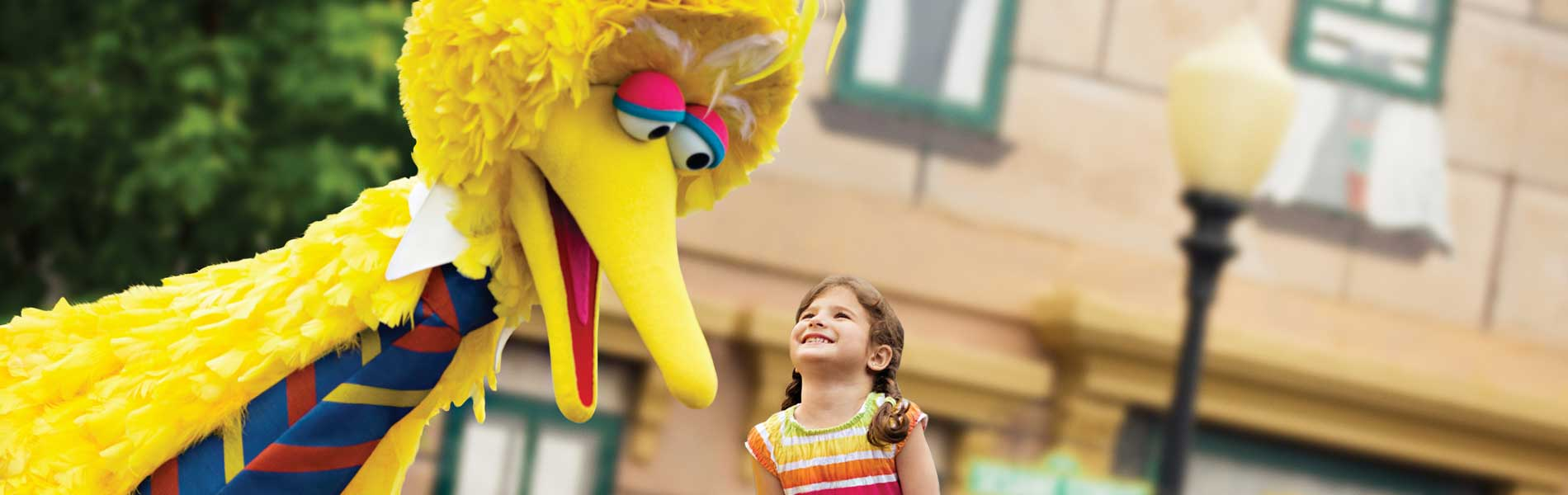 Big Bird and a young girl at Sesame Place theme park