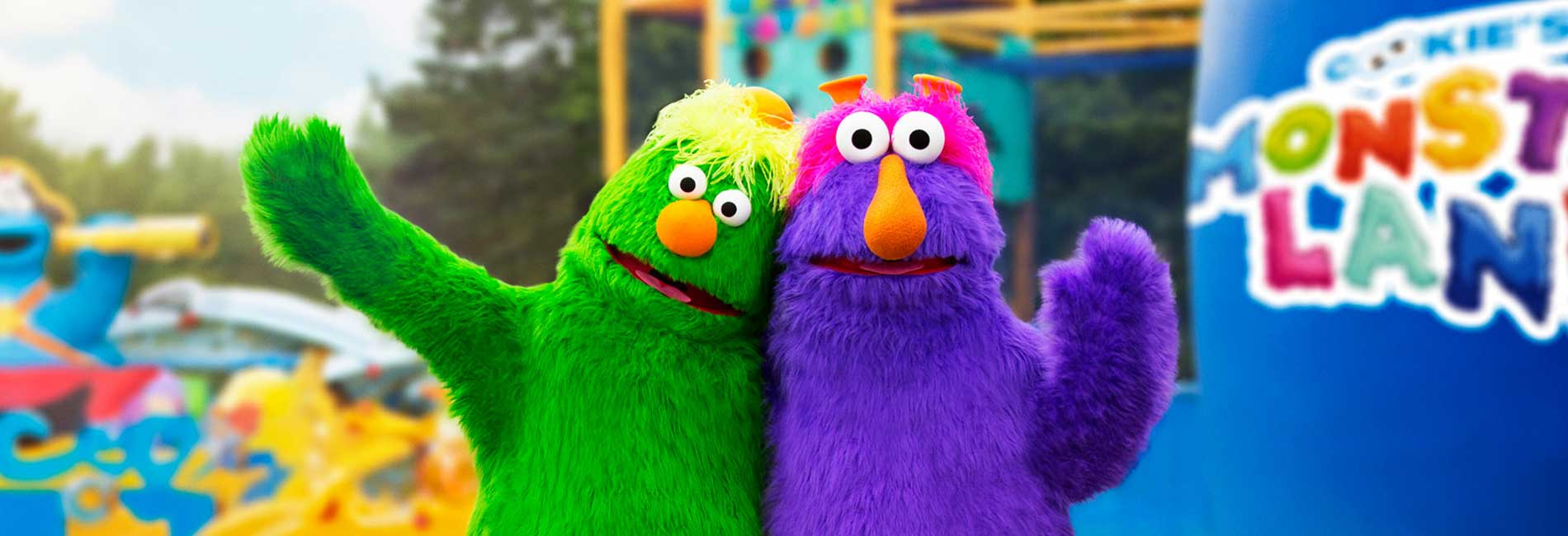 Honker and Dinger outside waving at Sesame Place theme park