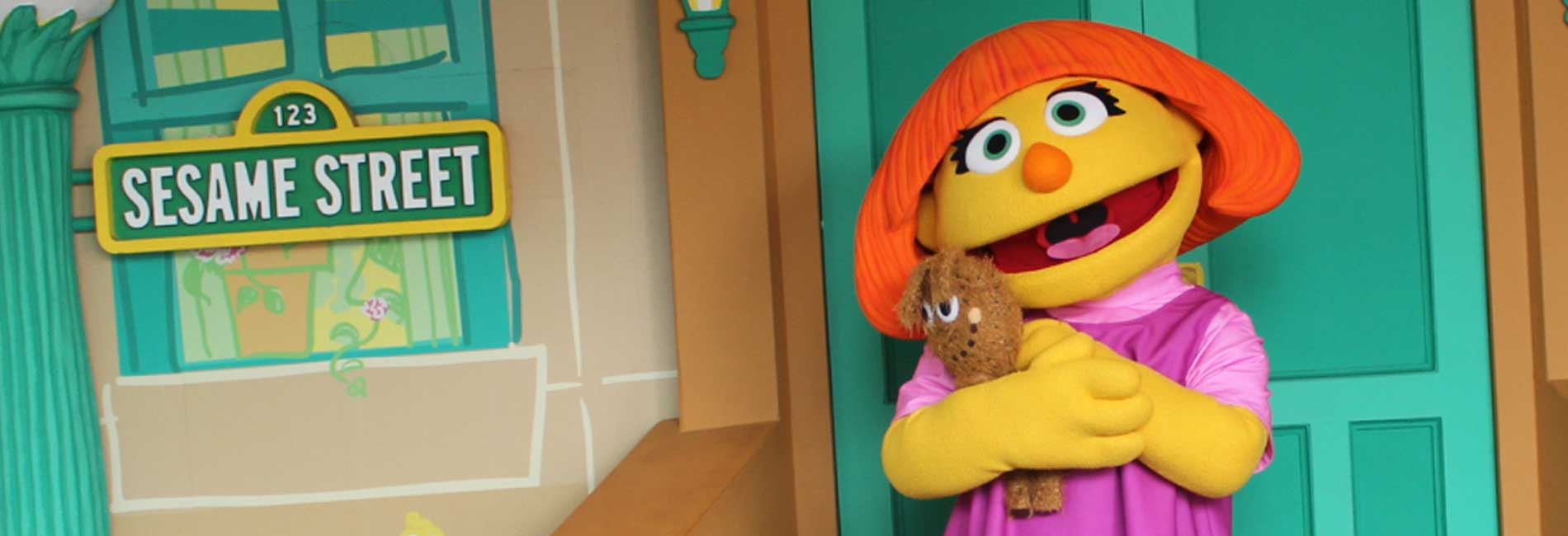 Julia hugs her stuffed toy at Sesame Place theme Park