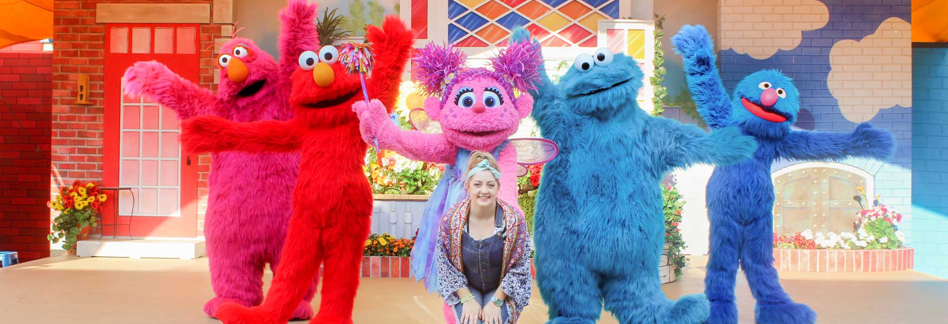 Telly Monster, Elmo, Abby Cadabby, Cookie Monster, Grover and a guest in The Magic of Art - live on stage at Sesame Place theme park