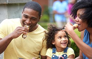 Family enjoying cannolis at Busch Gardens Williamsburg