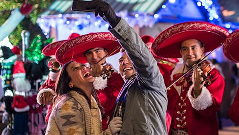 Couple taking selfie with the Merry Mariachis playing