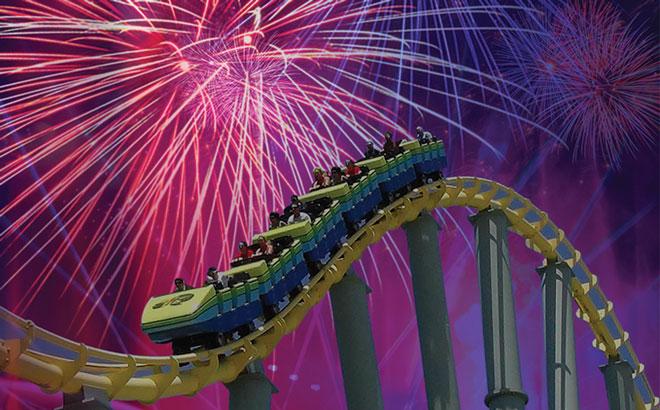 Roller Coaster in front of Fireworks
