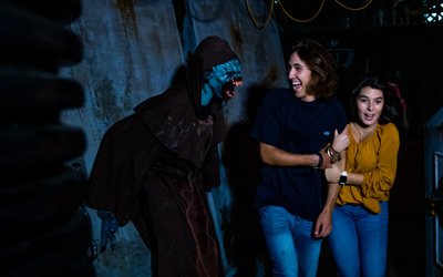 Guests getting scared in a Haunted House