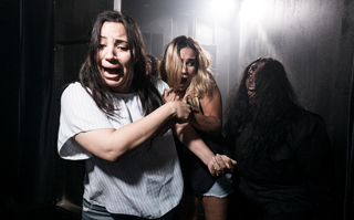 Guests being scared in a haunted house