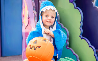 little boy in shark costume at SeaWorld San Antonio's Spooktacular