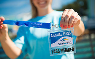 Woman hold SeaWorld San Antonio Annual Pass