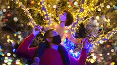 Dad and daughter viewing the lights around SeaWorld during Christmas Celebration