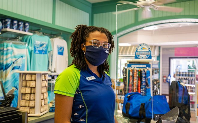 SeaWorld Team Member wearing a mask