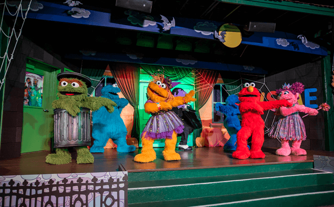 The Count, Elmo, and more Sesame Street friends dancing at the Not-Too-Spooky Howl-O-Ween Radio Show