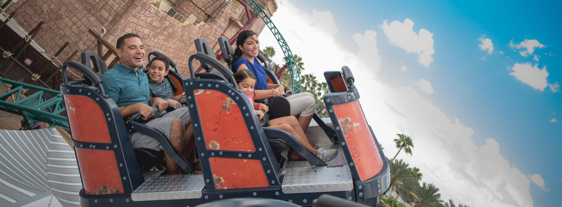 A family enjoys the spinning coaster ride called Cobra's Curse at Busch Gardens Tampa Bay, located in Florida.