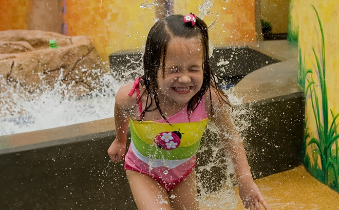 In the warmer seasons, let your kids splash about in our play areas