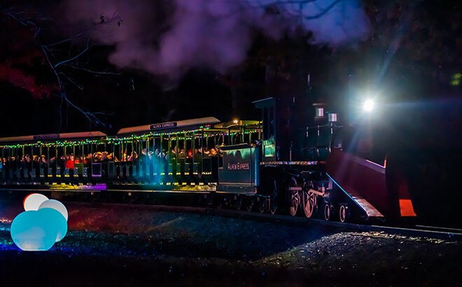 Lighted holiday train experience on the Christmas Town Express at Busch Gardens in Virginia