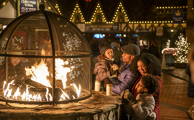 Family around a Fire pit in Germany during Christmas Town at Busch Gardens Williambsurg