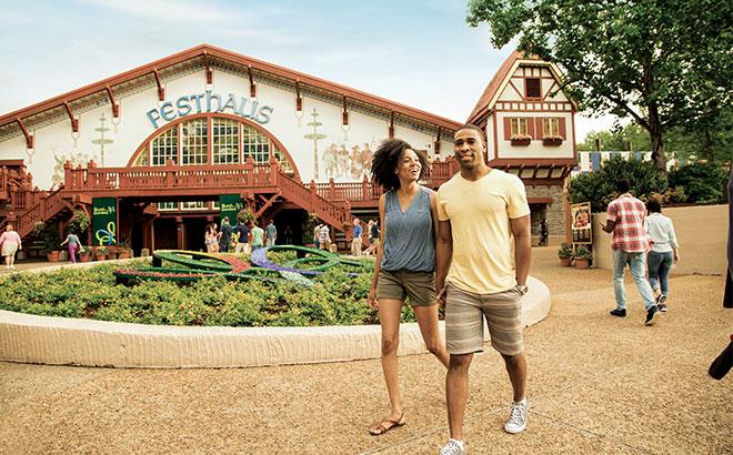 A man and a woman walking in Oktoberfest at Busch Gardens Williamsburg