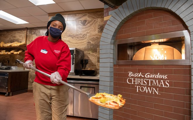 Culinary Ambassador cooking pizza during Christmas Town