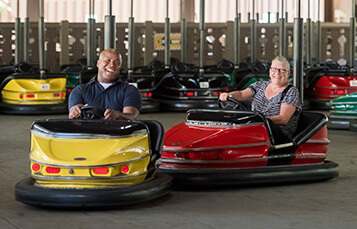 Man and women riding bumper cars at Der Autobahn at Busch Gardens Williamsburg