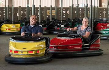 Man and women riding bumper cars at Der Autobahn at Busch Gardens Williamsburg