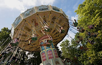 People riding amusement park ride Der Wirbelwind at Busch Gardens Williamsburg