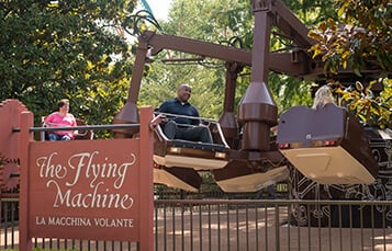 People riding The Flying Machine at Busch Gardens Williamsburg