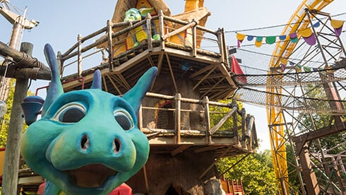 Land of the Dragons include a tree house, climbing ropes, slides, water play area and kids rides