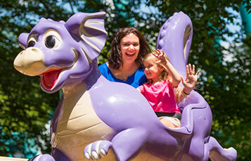 Land of the Dragons includes kids rides, tree house, climbing ropes, slides, and a water play area.