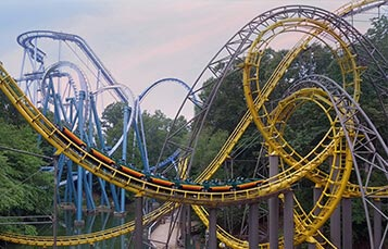 Blue and yellow steel loops of the Loch Ness Monster roller coaster
