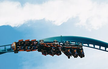 People riding the Tempesto roller coaster upside down at Busch Gardens Williamsburg